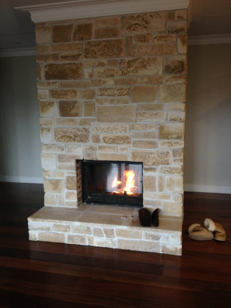 Dry Stacked Sandstone fireplace with grout