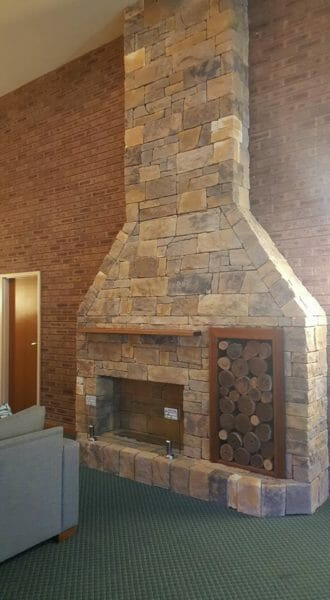 Dry stack Earth fireplace feature wall