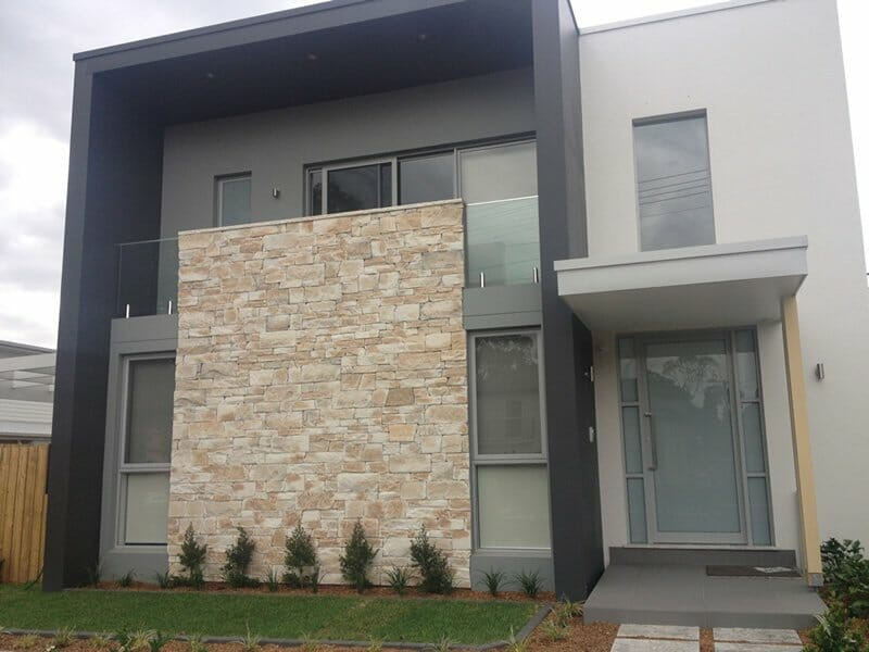 Stone building facades veneer stone stone cladding for Stacked stone house