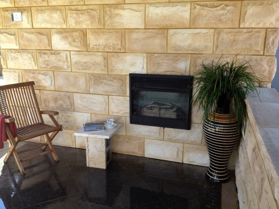 Dressed Edge Sandstone balcony fireplace feature wall