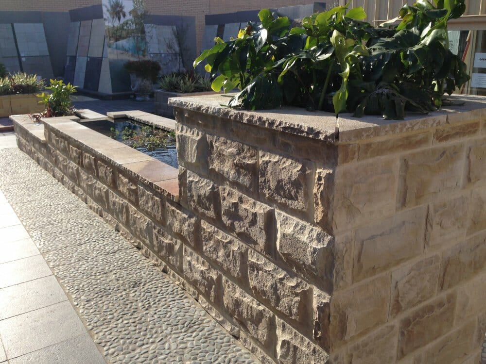 Dressed Edge Sandstone water feature retaining wall
